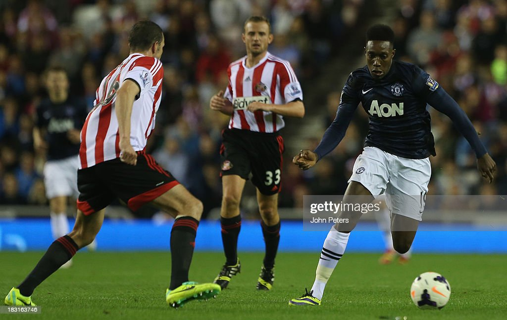 Danny Welbeck of Manchester United in action withJohn O'Shea of Sunderland during the Barclays Premier League match between Sunderland and Manchester United at the Stadium of Light on October 5, 2013 in Sunderland, England.
