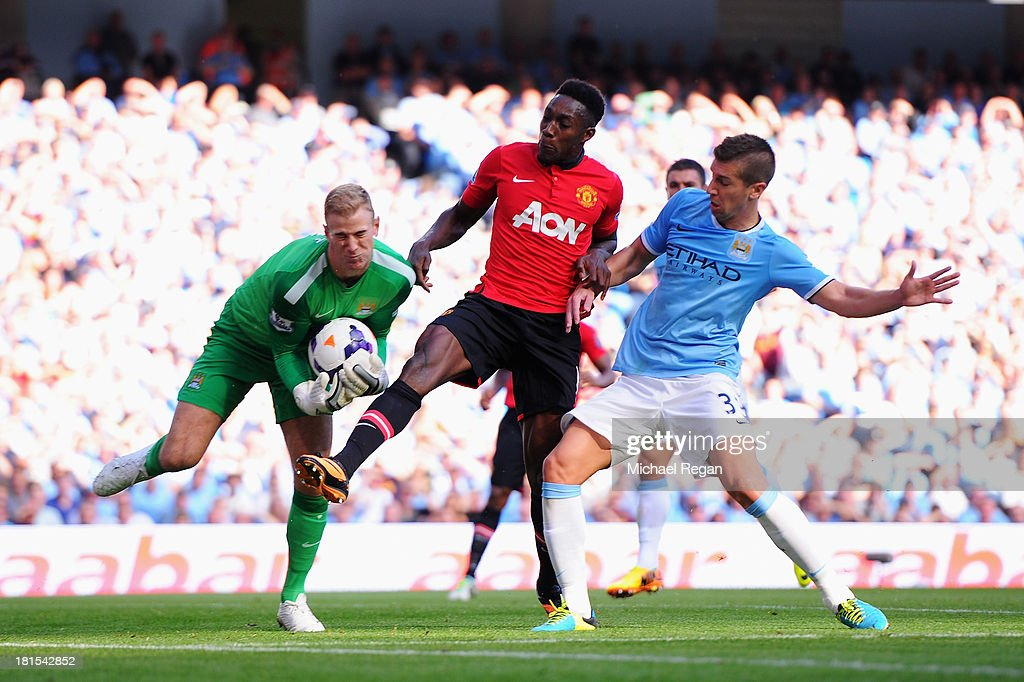 Danny Welbeck of Manchester United is foiled by Joe Hart (L) and Matija Nastasic of Manchester City (R) during the Barclays Premier League match between Manchester City and Manchester United at the Etihad Stadium on September 22, 2013 in Manchester, England.