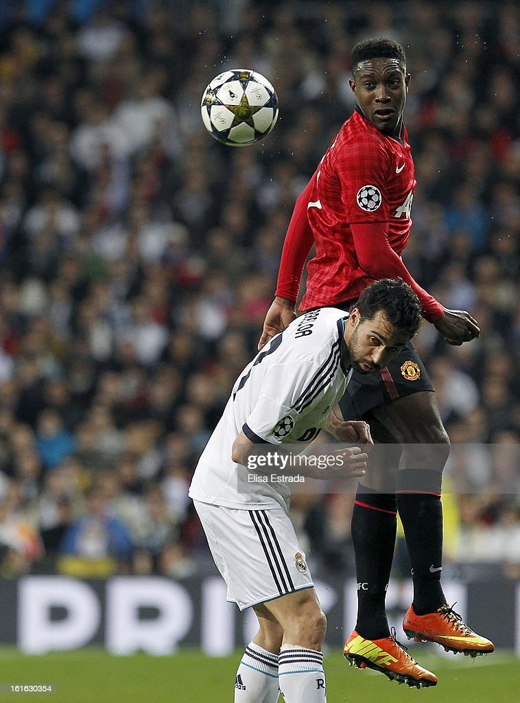 Danny Welbeck (TOP) of Manchester United jumps for a gigh ball in front of Alvaro Arbeloa of Real Madrid during the UEFA Champions League Round of 16 first leg match between Real Madrid and Manchester United at Estadio Santiago Bernabeu on February 13, 2013 in Madrid, Spain.