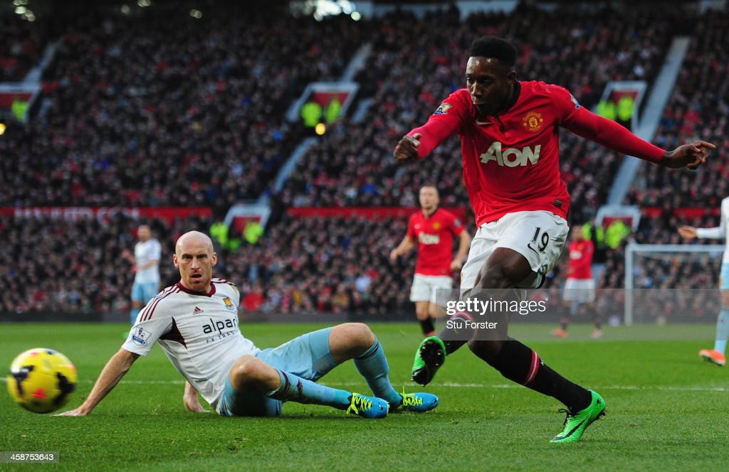 <a gi-track='captionPersonalityLinkClicked' href=/galleries/search?phrase=Danny+Welbeck&family=editorial&specificpeople=4223930 ng-click='$event.stopPropagation()'>Danny Welbeck</a> of Manchester United scores the opening goal during the Barclays Premier League match between Manchester United and West Ham United at Old Trafford on December 21, 2013 in Manchester, England.