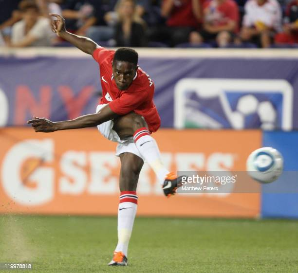 Danny Welbeck of Manchester United scores their fourth goal during the MLS All Star match between MLS All Stars and Manchester United at Red Bull...