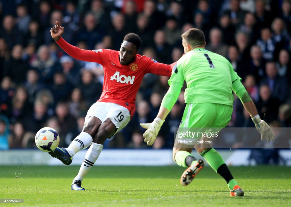 <a gi-track='captionPersonalityLinkClicked' href=/galleries/search?phrase=Danny+Welbeck&family=editorial&specificpeople=4223930 ng-click='$event.stopPropagation()'>Danny Welbeck</a> of Manchester United shoots past Ben Forster of West Bromwich Albion to score their third goal during the Barclays Premier League match between West Bromwich Albion and Manchester United at The Hawthorns on March 8, 2014 in West Bromwich, England.