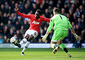Danny Welbeck of Manchester United shoots past Ben Forster of West Bromwich Albion to score their third goal during the Barclays Premier League match...