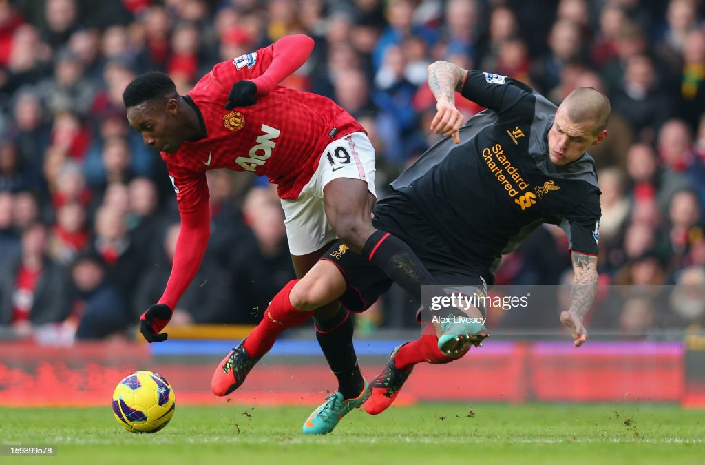 <a gi-track='captionPersonalityLinkClicked' href=/galleries/search?phrase=Danny+Welbeck&family=editorial&specificpeople=4223930 ng-click='$event.stopPropagation()'>Danny Welbeck</a> of Manchester United tangles with <a gi-track='captionPersonalityLinkClicked' href=/galleries/search?phrase=Martin+Skrtel&family=editorial&specificpeople=5554576 ng-click='$event.stopPropagation()'>Martin Skrtel</a> of Liverpool during the Barclays Premier League match between Manchester United and Liverpool at Old Trafford on January 13, 2013 in Manchester, England.