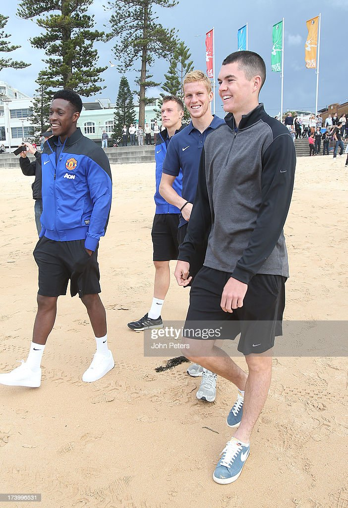 <a gi-track='captionPersonalityLinkClicked' href=/galleries/search?phrase=Danny+Welbeck&family=editorial&specificpeople=4223930 ng-click='$event.stopPropagation()'>Danny Welbeck</a>, Phil Jones, Ben Amos and Michael Keane of Manchester United visits Manley Beach as part of their pre-season tour of Bangkok, Australia, China, Japan and Hong Kong on July 19, 2013 in Sydney, Australia.