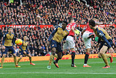 Danny Welbeck scores a goal for Arsenal during the Barclays Premier League match between Manchester United and Arsenal at Old Trafford on February 28...