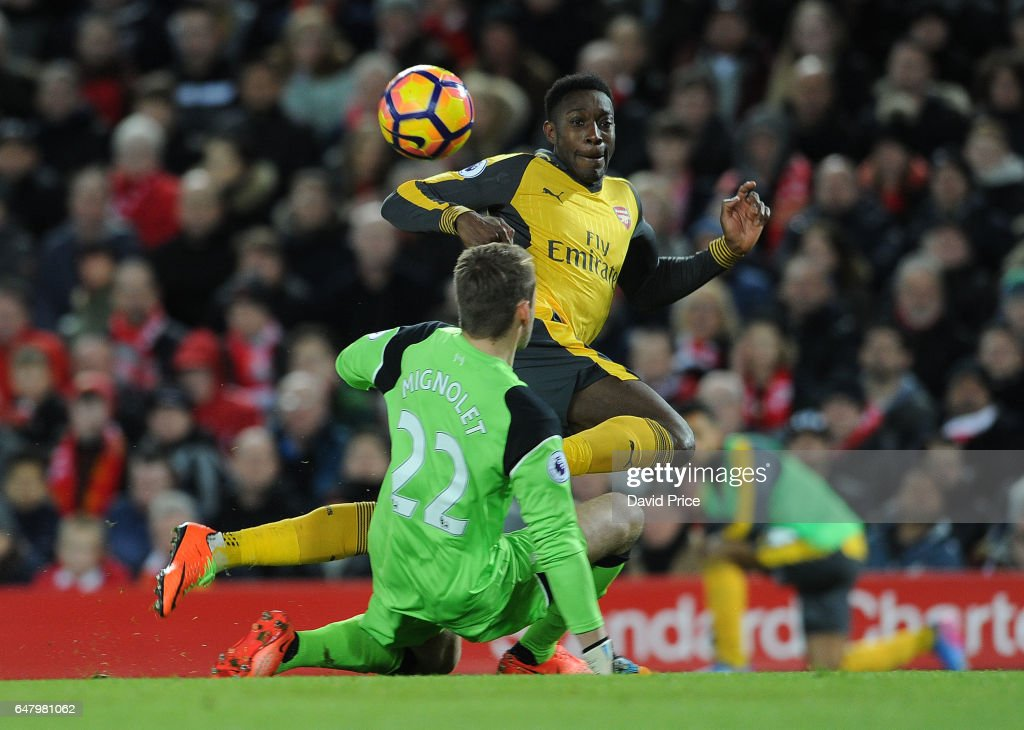 Danny Welbeck scores a goal for Arsenal past Simon Mignolet of Liverpool during the Premier League match between Liverpool and Arsenal at Anfield on March 4, 2017 in Liverpool, England.