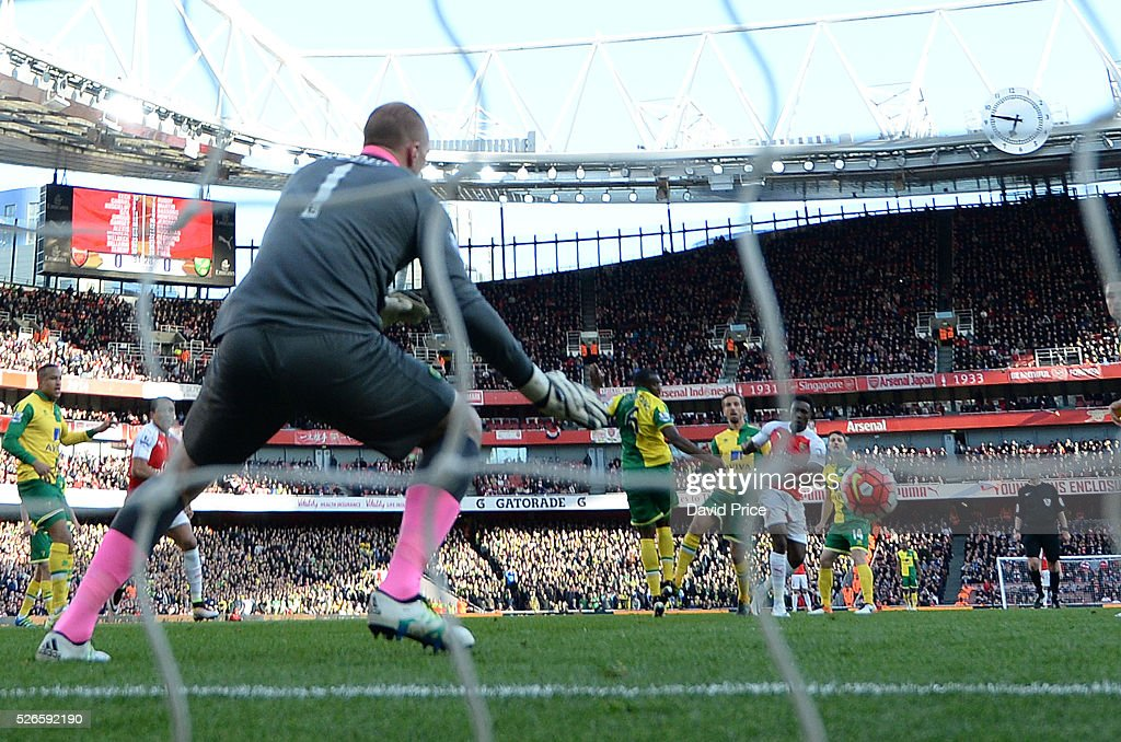 Danny Welbeck scores Arsenal's goal past <a gi-track='captionPersonalityLinkClicked' href=/galleries/search?phrase=John+Ruddy&family=editorial&specificpeople=822348 ng-click='$event.stopPropagation()'>John Ruddy</a> of Norwich during the Barclays Premier League match between Arsenal and Norwich City at on April 30th, 2016 in London, England