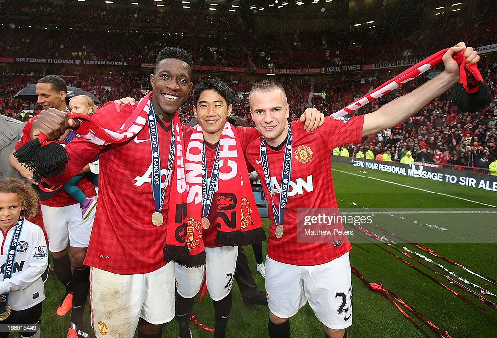 Danny Welbeck, Shinji Kagawa and Tom Cleverley of Manchester United celebrate after the Barclays Premier League match between Manchester United and Swansea City at Old Trafford on May 12, 2013 in Manchester, England.