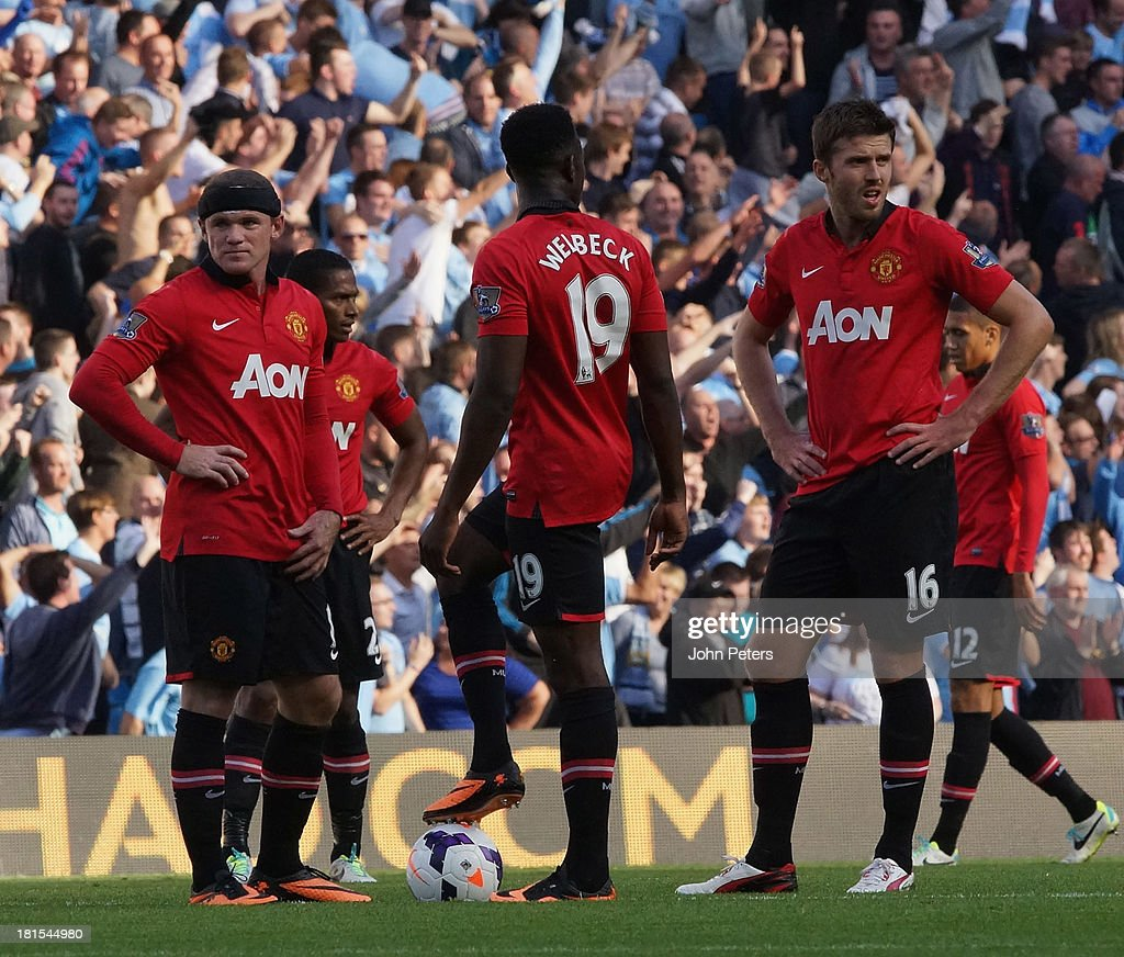 Danny Welbeck, Wayne Rooney and Michael Carrick of Manchester United react to conceding a goal during the Barclays Premier League match between Manchester City and Manchester United at the Etihad Stadium on September 22, 2013 in Manchester, England.