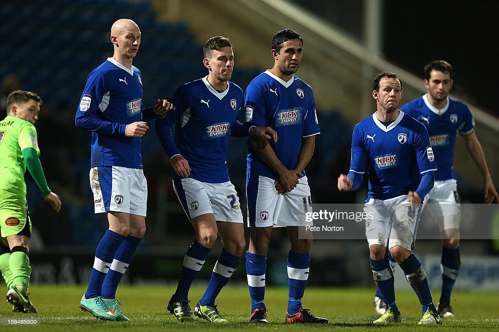 Danny Whitakeker, Mark Randall, Jack Lester and Sam Togwell of Chesterfield defend a free kick during the npower League Two match between Chesterfield and Northampton Town at the Proact Srtadium on January 12, 2013 in Chesterfield, England.