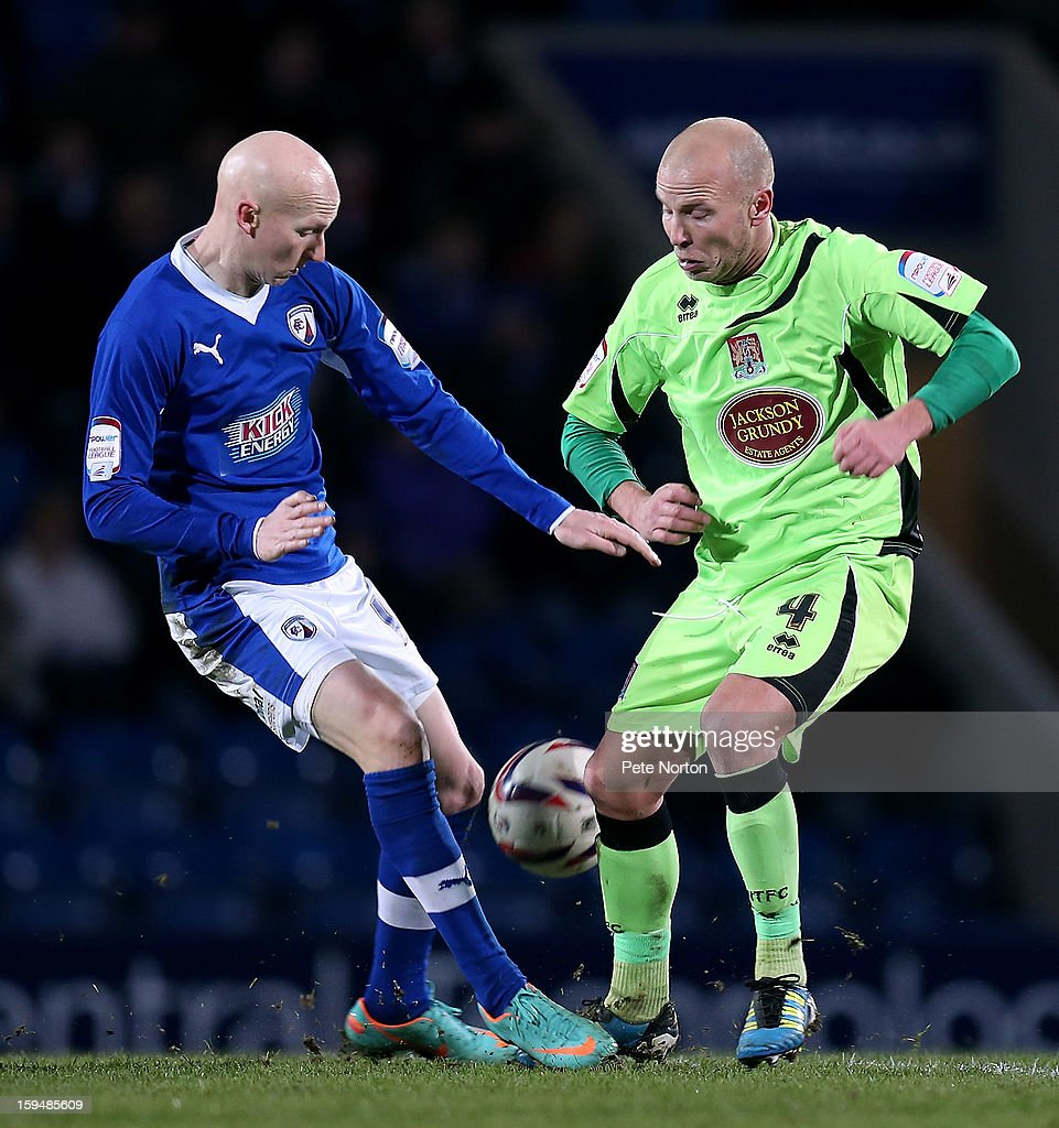 Danny Whitaker of Chesterfield contests the ball with Luke Guttridge of Northampton Town during the npower League Two match between Chesterfield and Northampton Town at the Proact Srtadium on January 12, 2013 in Chesterfield, England.