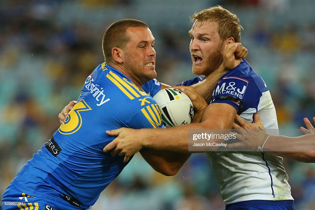 Danny Wicks of the Eels is tackled by Aiden Tolman of the Bulldogs during the round nine NRL match between the Parramatta Eels and the Canterbury Bulldogs at ANZ Stadium on April 29, 2016 in Sydney, Australia.