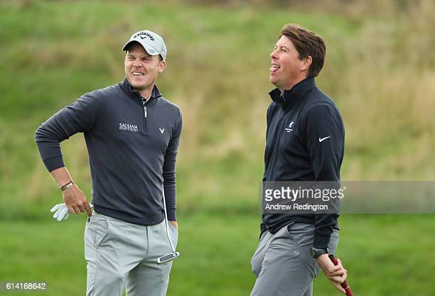 Danny Willett of England and former footballer Darren Anderton share a joke during the Hero ProAm at The Grove on October 12 2016 in Watford England