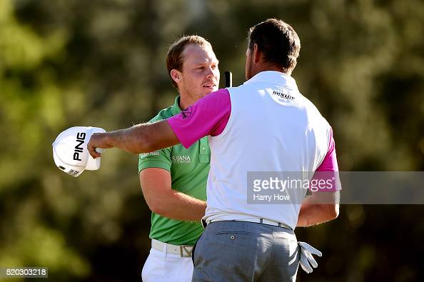 Danny Willett of England and Lee Westwood of England embrace after finishing on the 18th green during the final round of the 2016 Masters Tournament...