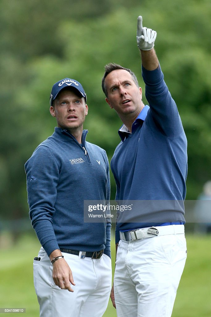 <a gi-track='captionPersonalityLinkClicked' href=/galleries/search?phrase=Danny+Willett&family=editorial&specificpeople=4488861 ng-click='$event.stopPropagation()'>Danny Willett</a> of England and <a gi-track='captionPersonalityLinkClicked' href=/galleries/search?phrase=Michael+Vaughan&family=editorial&specificpeople=179446 ng-click='$event.stopPropagation()'>Michael Vaughan</a> look on during the Pro-Am prior to the BMW PGA Championship at Wentworth on May 25, 2016 in Virginia Water, England.