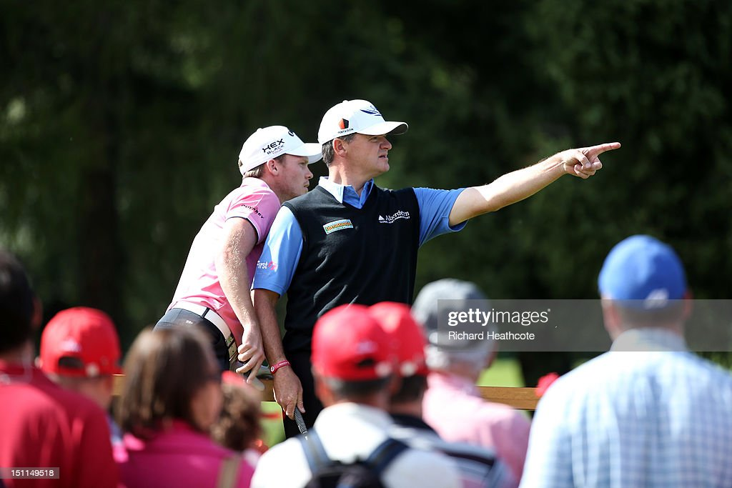 <a gi-track='captionPersonalityLinkClicked' href=/galleries/search?phrase=Danny+Willett&family=editorial&specificpeople=4488861 ng-click='$event.stopPropagation()'>Danny Willett</a> of England and <a gi-track='captionPersonalityLinkClicked' href=/galleries/search?phrase=Paul+Lawrie&family=editorial&specificpeople=202995 ng-click='$event.stopPropagation()'>Paul Lawrie</a> of Scotland in action during the final round of the Omega European Masters at Crans-sur-Sierre Golf Club on September 2, 2012 in Crans, Switzerland.