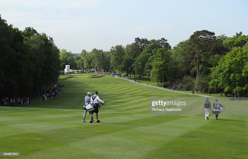 <a gi-track='captionPersonalityLinkClicked' href=/galleries/search?phrase=Danny+Willett&family=editorial&specificpeople=4488861 ng-click='$event.stopPropagation()'>Danny Willett</a> of England and <a gi-track='captionPersonalityLinkClicked' href=/galleries/search?phrase=Victor+Dubuisson&family=editorial&specificpeople=3333395 ng-click='$event.stopPropagation()'>Victor Dubuisson</a> of France walk down the 4th hole during day two of the BMW PGA Championship at Wentworth on May 27, 2016 in Virginia Water, England.