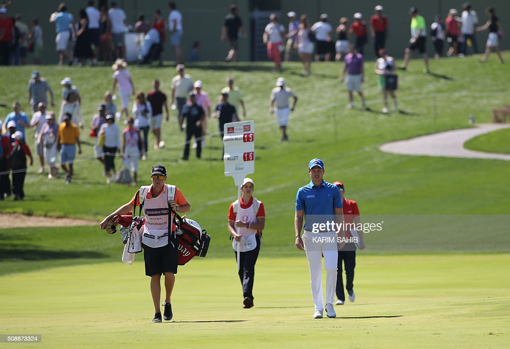 Danny Willett (R) of England attend the final round of the 2016 Dubai Desert Classic at the Emirates Golf Club in Dubai on February 7, 2016. SAHIB