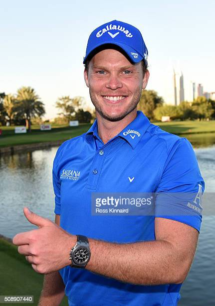 Danny Willett of England celebrates after the final round of the Omega Dubai Desert Classic on the Majlis Course at the Emirates Golf Club on...