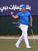 Danny Willett of England celebrates after winning the 2016 Dubai Desert Classic at the Emirates Golf Club in Dubai on February 7 2016 / AFP / KARIM...