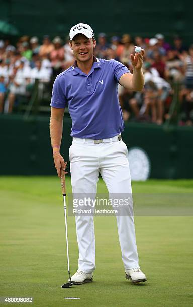 Danny Willett of England celebrates as he holes the winning putt to secure victory during the final round of the Nedbank Golf Challenge at the Gary...