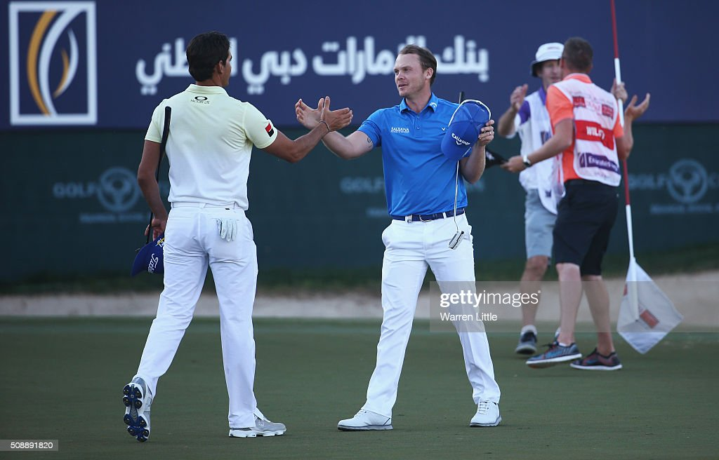 <a gi-track='captionPersonalityLinkClicked' href=/galleries/search?phrase=Danny+Willett&family=editorial&specificpeople=4488861 ng-click='$event.stopPropagation()'>Danny Willett</a> of England celebrates his victory on the 18th green as he shakes hands with Rafa Cabrera-Bello of Spain during the final round of the Omega Dubai Desert Classic at the Emirates Golf Club on February 7, 2016 in Dubai, United Arab Emirates.