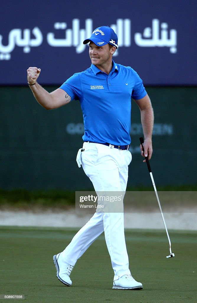 Danny Willett of England celebrates his victory on the 18th green during the final round of the Omega Dubai Desert Classic on the Majlis Course at...