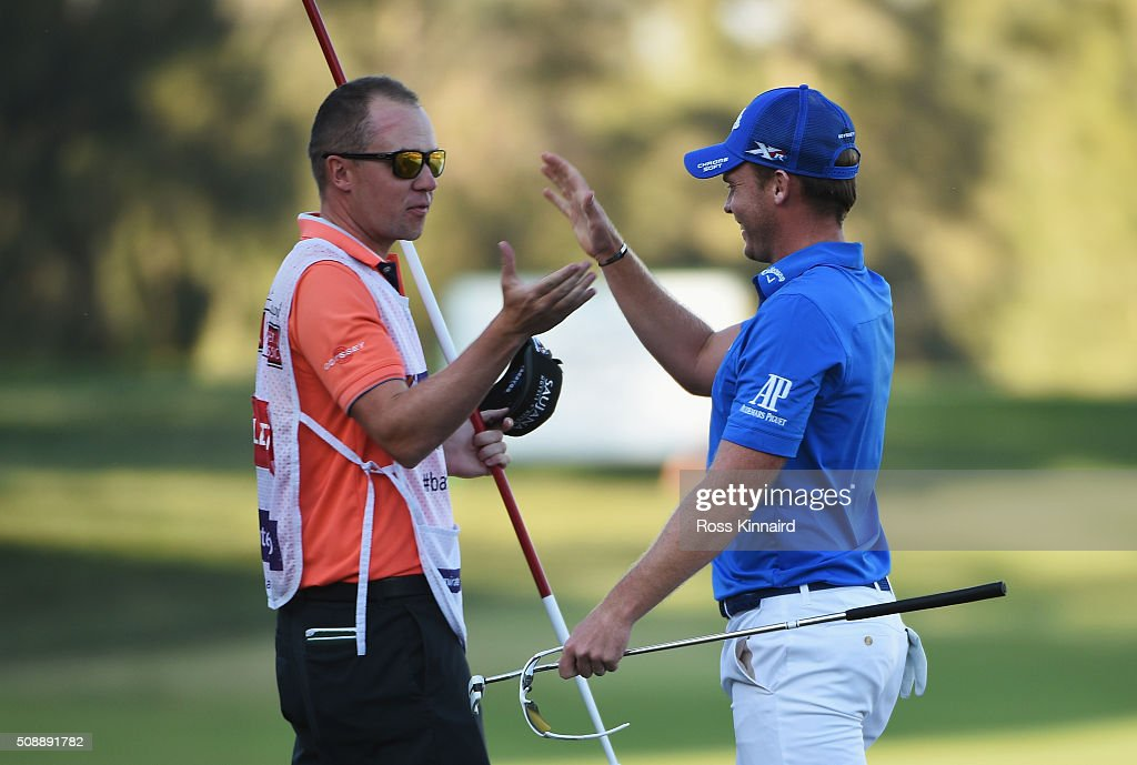 Danny Willett of England celebrates his victory with caddie Jonathan Smart on the 18th green during the final round of the Omega Dubai Desert Classic at the Emirates Golf Club on February 7, 2016 in Dubai, United Arab Emirates.