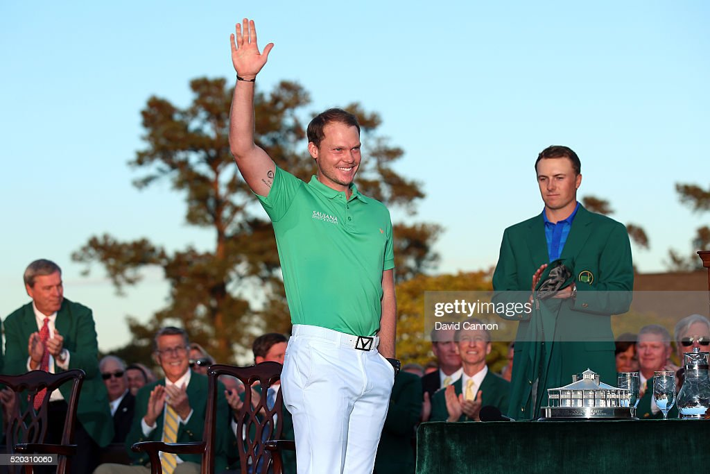 Danny Willett of England celebrates winning during the green jacket ceremony with Jordan Spieth of the United States during the final round of the 2016 Masters Tournament at Augusta National Golf Club on April 10, 2016 in Augusta, Georgia.