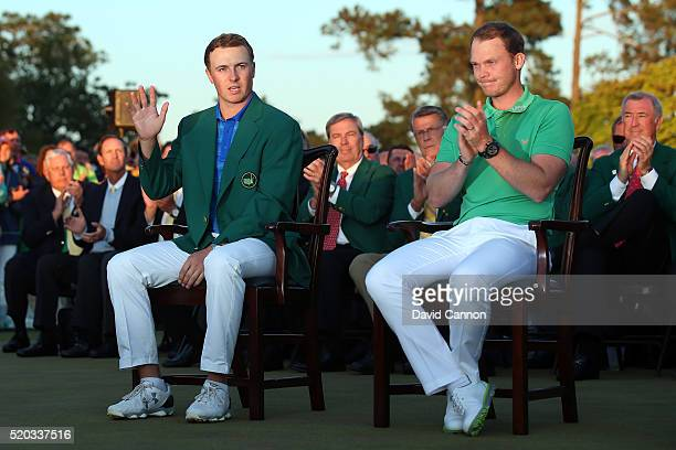 Danny Willett of England celebrates winning during the green jacket ceremony with Jordan Spieth of the United States after the final round of the...