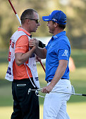Danny Willett of England celebrates with his caddie Jonathan Smart after the final round of the Omega Dubai Desert Classic on the Majlis Course at...