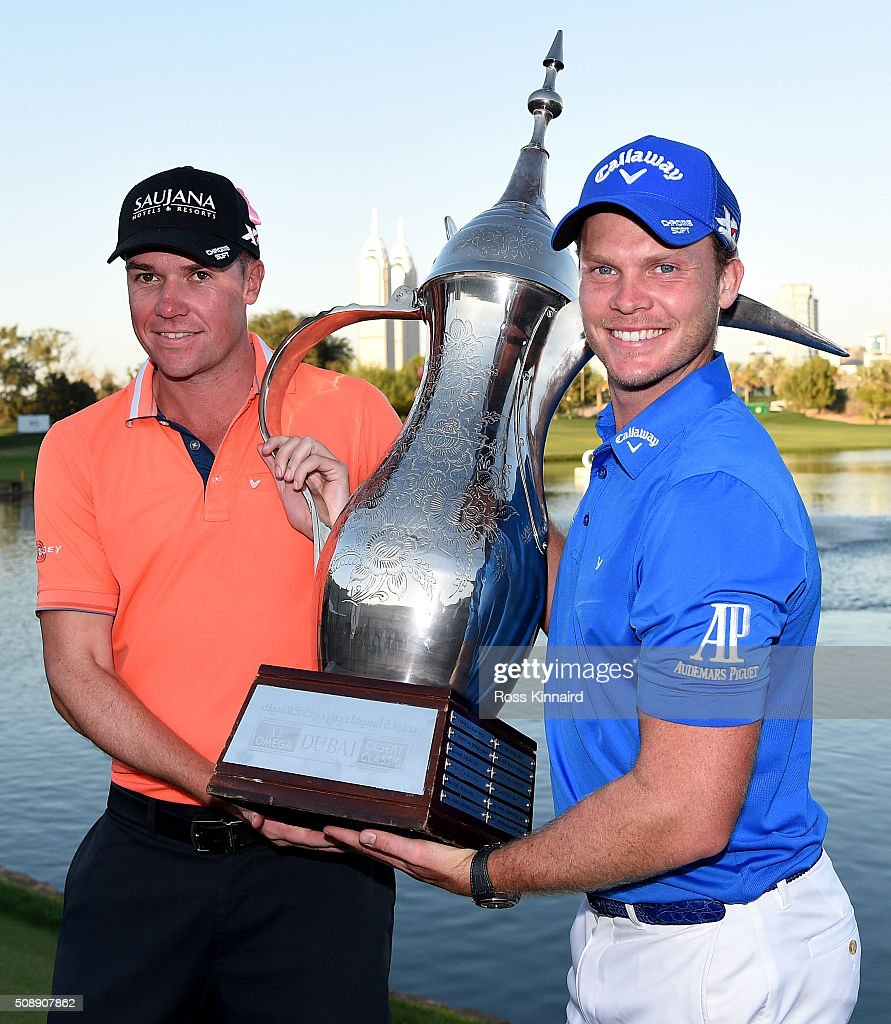 <a gi-track='captionPersonalityLinkClicked' href=/galleries/search?phrase=Danny+Willett&family=editorial&specificpeople=4488861 ng-click='$event.stopPropagation()'>Danny Willett</a> of England celebrates with his caddie Jonathan Smart after the final round of the Omega Dubai Desert Classic on the Majlis Course at the Emirates Golf Club on February 7, 2016 in Dubai, United Arab Emirates.