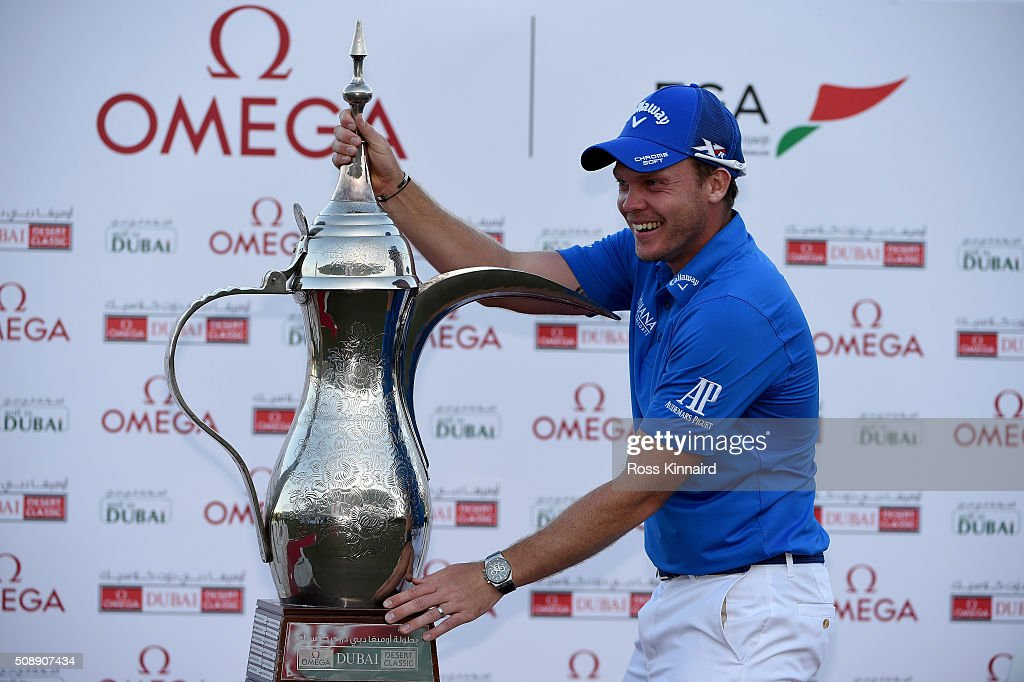 <a gi-track='captionPersonalityLinkClicked' href=/galleries/search?phrase=Danny+Willett&family=editorial&specificpeople=4488861 ng-click='$event.stopPropagation()'>Danny Willett</a> of England celebrates with the winners trophy after the final round of the Omega Dubai Desert Classic on the Majlis Course at the Emirates Golf Club on February 7, 2016 in Dubai, United Arab Emirates.