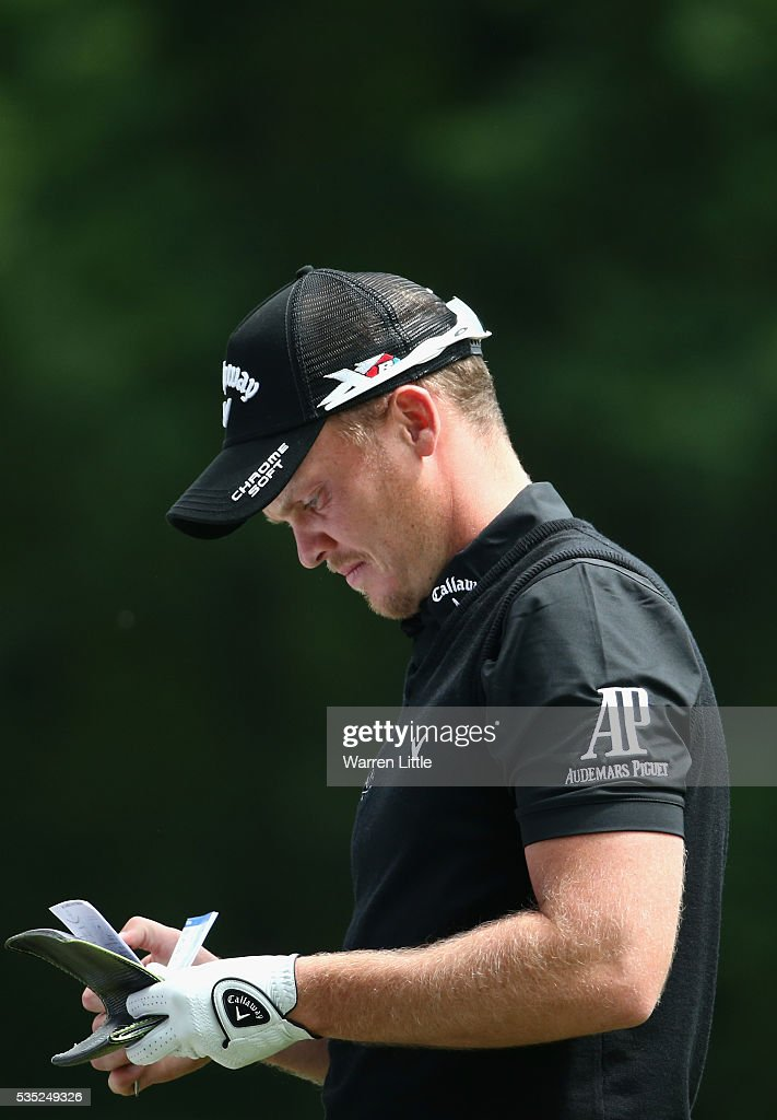 <a gi-track='captionPersonalityLinkClicked' href=/galleries/search?phrase=Danny+Willett&family=editorial&specificpeople=4488861 ng-click='$event.stopPropagation()'>Danny Willett</a> of England checks a yardage on the 3rd hole during day four of the BMW PGA Championship at Wentworth on May 29, 2016 in Virginia Water, England.