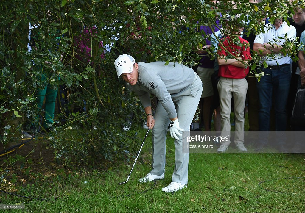 <a gi-track='captionPersonalityLinkClicked' href=/galleries/search?phrase=Danny+Willett&family=editorial&specificpeople=4488861 ng-click='$event.stopPropagation()'>Danny Willett</a> of England checks his lie on the 17th hole during day two of the BMW PGA Championship at Wentworth on May 27, 2016 in Virginia Water, England.