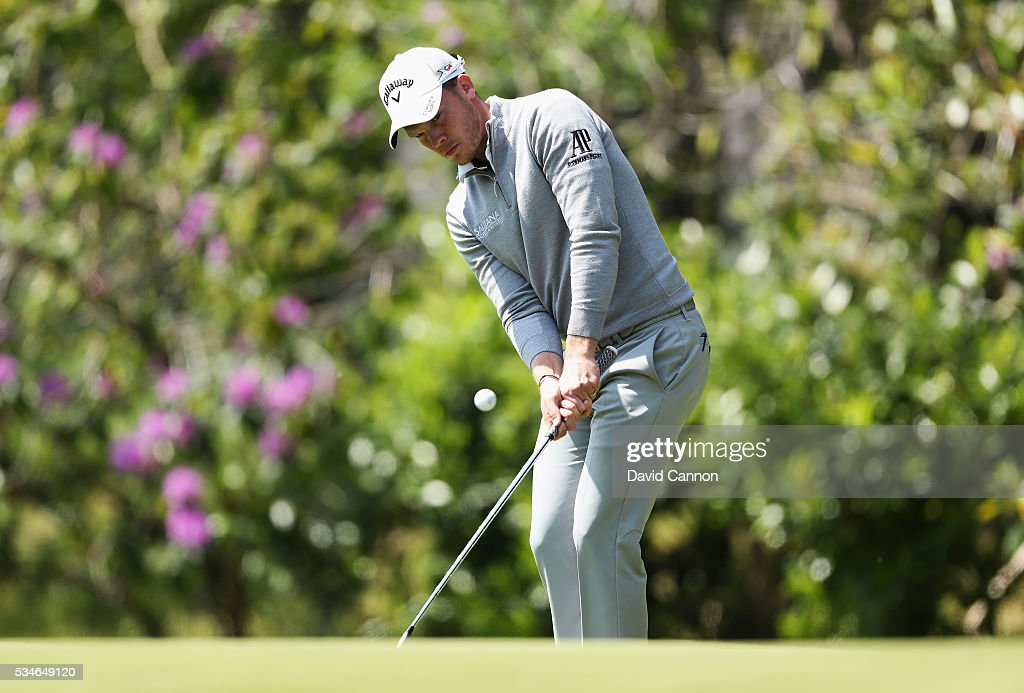 <a gi-track='captionPersonalityLinkClicked' href=/galleries/search?phrase=Danny+Willett&family=editorial&specificpeople=4488861 ng-click='$event.stopPropagation()'>Danny Willett</a> of England chips on to the 16th green during day two of the BMW PGA Championship at Wentworth on May 27, 2016 in Virginia Water, England.