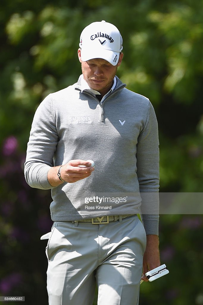 <a gi-track='captionPersonalityLinkClicked' href=/galleries/search?phrase=Danny+Willett&family=editorial&specificpeople=4488861 ng-click='$event.stopPropagation()'>Danny Willett</a> of England examines his ball during day two of the BMW PGA Championship at Wentworth on May 27, 2016 in Virginia Water, England.