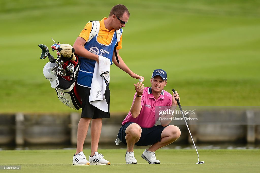 <a gi-track='captionPersonalityLinkClicked' href=/galleries/search?phrase=Danny+Willett&family=editorial&specificpeople=4488861 ng-click='$event.stopPropagation()'>Danny Willett</a> of England hands his ball to his caddie Jonathan Smart during a pro-am round ahead of the 100th Open de France at Le Golf National on June 29, 2016 in Paris, France.