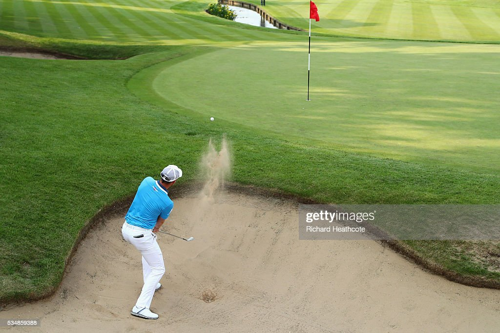 <a gi-track='captionPersonalityLinkClicked' href=/galleries/search?phrase=Danny+Willett&family=editorial&specificpeople=4488861 ng-click='$event.stopPropagation()'>Danny Willett</a> of England hits from a bunker on the 18th hole during day three of the BMW PGA Championship at Wentworth on May 28, 2016 in Virginia Water, England.