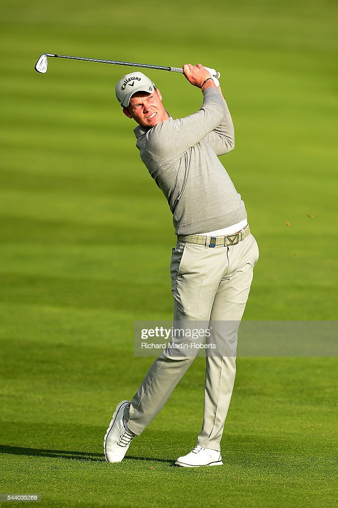 <a gi-track='captionPersonalityLinkClicked' href=/galleries/search?phrase=Danny+Willett&family=editorial&specificpeople=4488861 ng-click='$event.stopPropagation()'>Danny Willett</a> of England hits his 2nd shot on the 10th hole during the second round of the 100th Open de France at Le Golf National on July 1, 2016 in Paris, France.