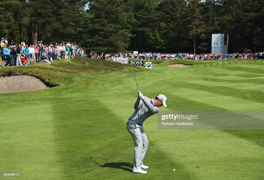 <a gi-track='captionPersonalityLinkClicked' href=/galleries/search?phrase=Danny+Willett&family=editorial&specificpeople=4488861 ng-click='$event.stopPropagation()'>Danny Willett</a> of England hits his 2nd shot on the 11th hole during day two of the BMW PGA Championship at Wentworth on May 27, 2016 in Virginia Water, England.