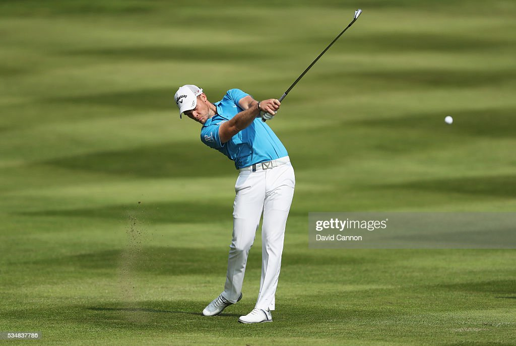 Danny Willett of England hits his 2nd shot on the 12th hole during day three of the BMW PGA Championship at Wentworth on May 28, 2016 in Virginia Water, England.