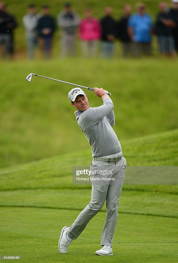 <a gi-track='captionPersonalityLinkClicked' href=/galleries/search?phrase=Danny+Willett&family=editorial&specificpeople=4488861 ng-click='$event.stopPropagation()'>Danny Willett</a> of England hits his 2nd shot on the 12th hole during the second round of the 100th Open de France at Le Golf National on July 1, 2016 in Paris, France.
