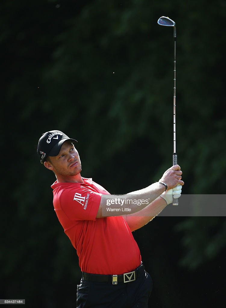 <a gi-track='captionPersonalityLinkClicked' href=/galleries/search?phrase=Danny+Willett&family=editorial&specificpeople=4488861 ng-click='$event.stopPropagation()'>Danny Willett</a> of England hits his 2nd shot on the 17th hole during day one of the BMW PGA Championship at Wentworth on May 26, 2016 in Virginia Water, England.