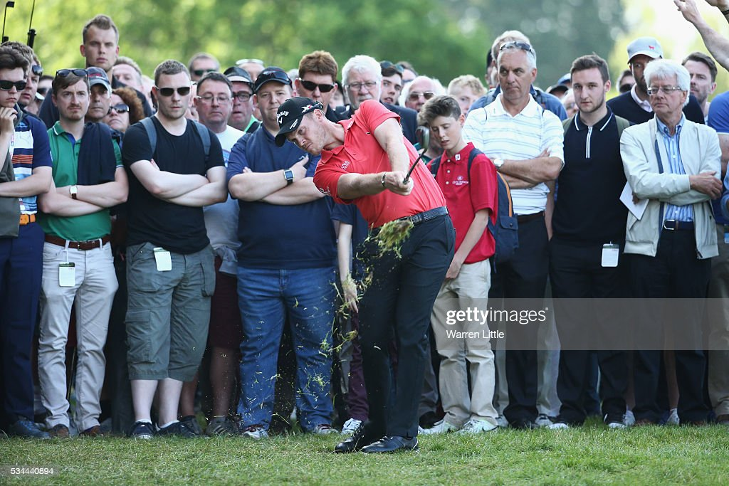 <a gi-track='captionPersonalityLinkClicked' href=/galleries/search?phrase=Danny+Willett&family=editorial&specificpeople=4488861 ng-click='$event.stopPropagation()'>Danny Willett</a> of England hits his 2nd shot on the 18th hole during day one of the BMW PGA Championship at Wentworth on May 26, 2016 in Virginia Water, England.