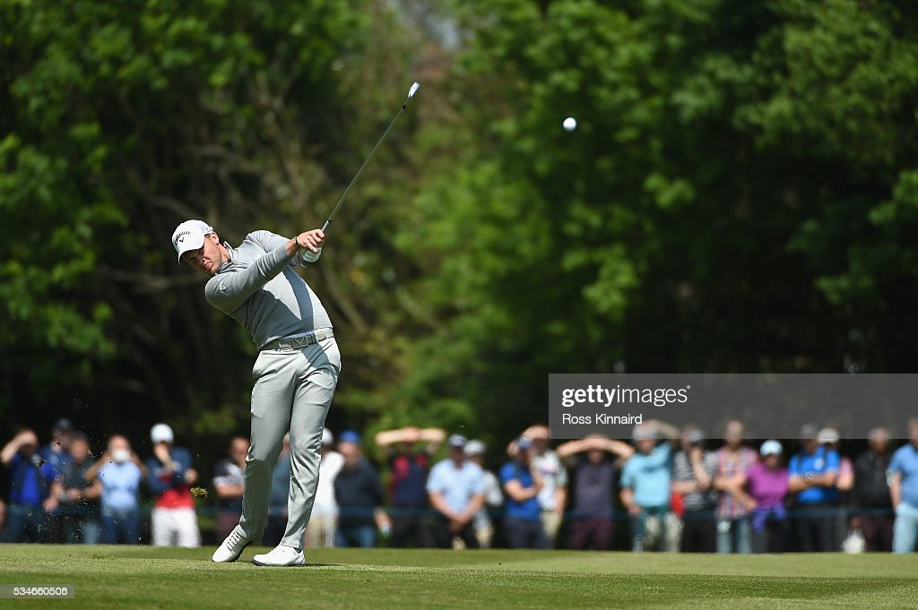 <a gi-track='captionPersonalityLinkClicked' href=/galleries/search?phrase=Danny+Willett&family=editorial&specificpeople=4488861 ng-click='$event.stopPropagation()'>Danny Willett</a> of England hits his 2nd shot on the 18th hole during day two of the BMW PGA Championship at Wentworth on May 27, 2016 in Virginia Water, England.