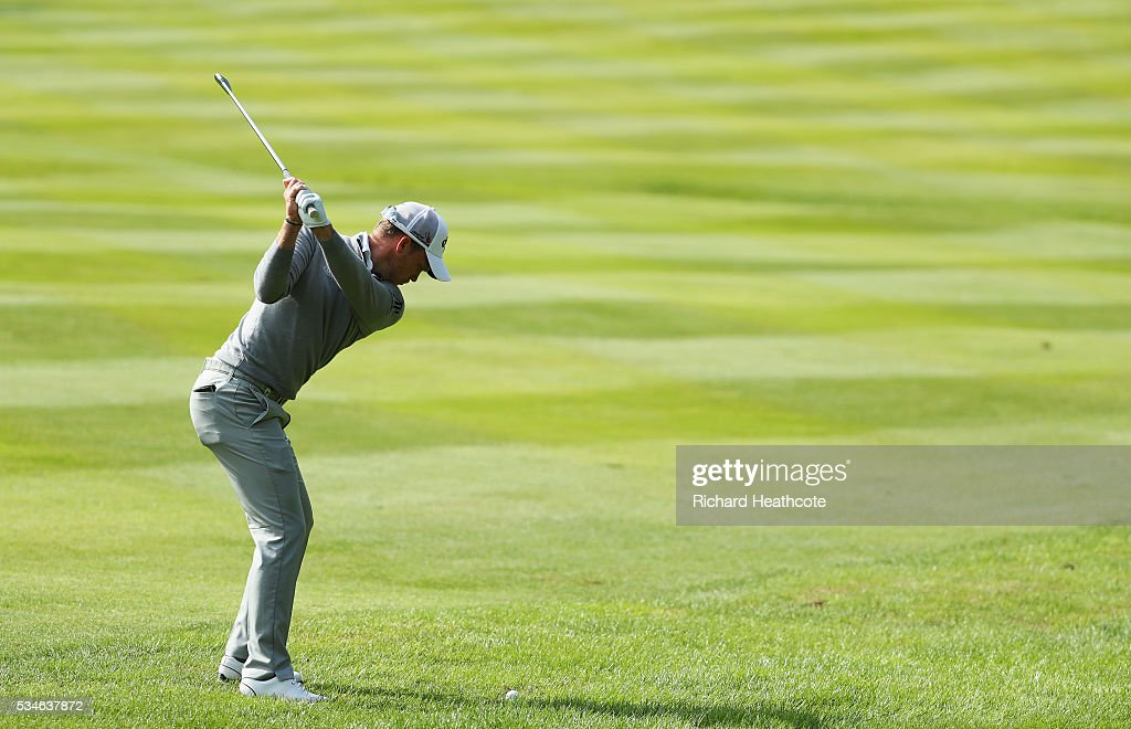 Danny Willett of England hits his 2nd shot on the 4th hole during day two of the BMW PGA Championship at Wentworth on May 27, 2016 in Virginia Water, England.