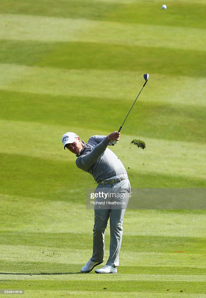<a gi-track='captionPersonalityLinkClicked' href=/galleries/search?phrase=Danny+Willett&family=editorial&specificpeople=4488861 ng-click='$event.stopPropagation()'>Danny Willett</a> of England hits his 2nd shot on the 7th hole during day two of the BMW PGA Championship at Wentworth on May 27, 2016 in Virginia Water, England.