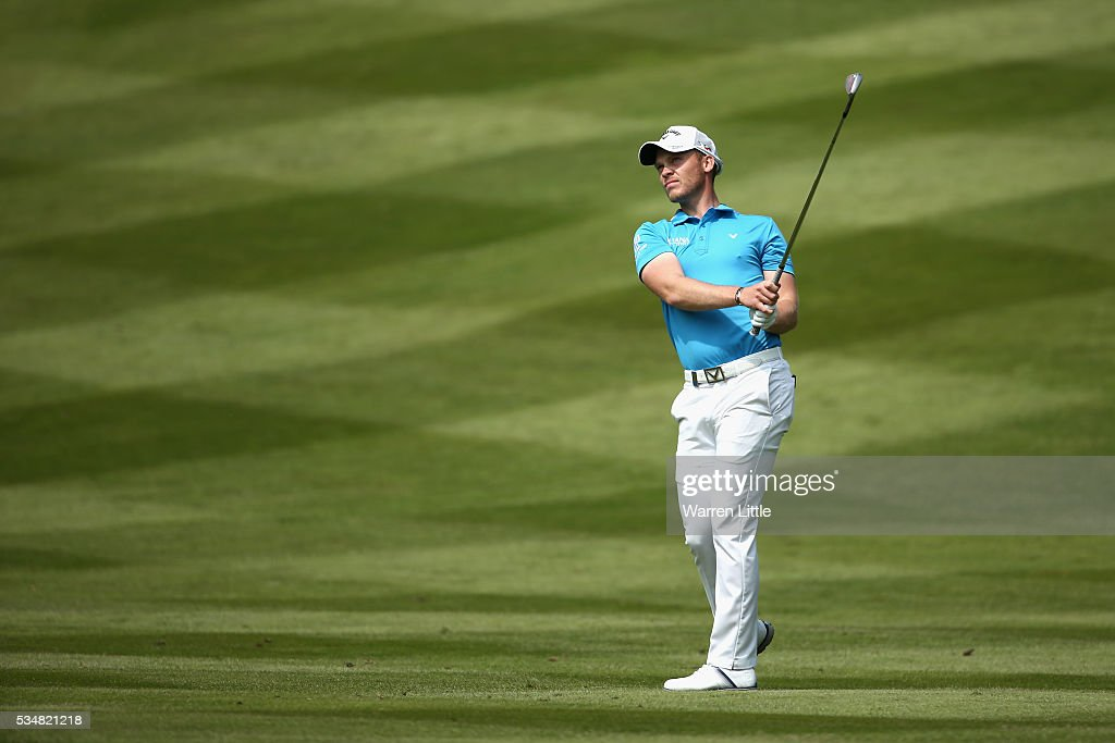 <a gi-track='captionPersonalityLinkClicked' href=/galleries/search?phrase=Danny+Willett&family=editorial&specificpeople=4488861 ng-click='$event.stopPropagation()'>Danny Willett</a> of England hits his 2nd shot on the 7th hole during day three of the BMW PGA Championship at Wentworth on May 28, 2016 in Virginia Water, England.